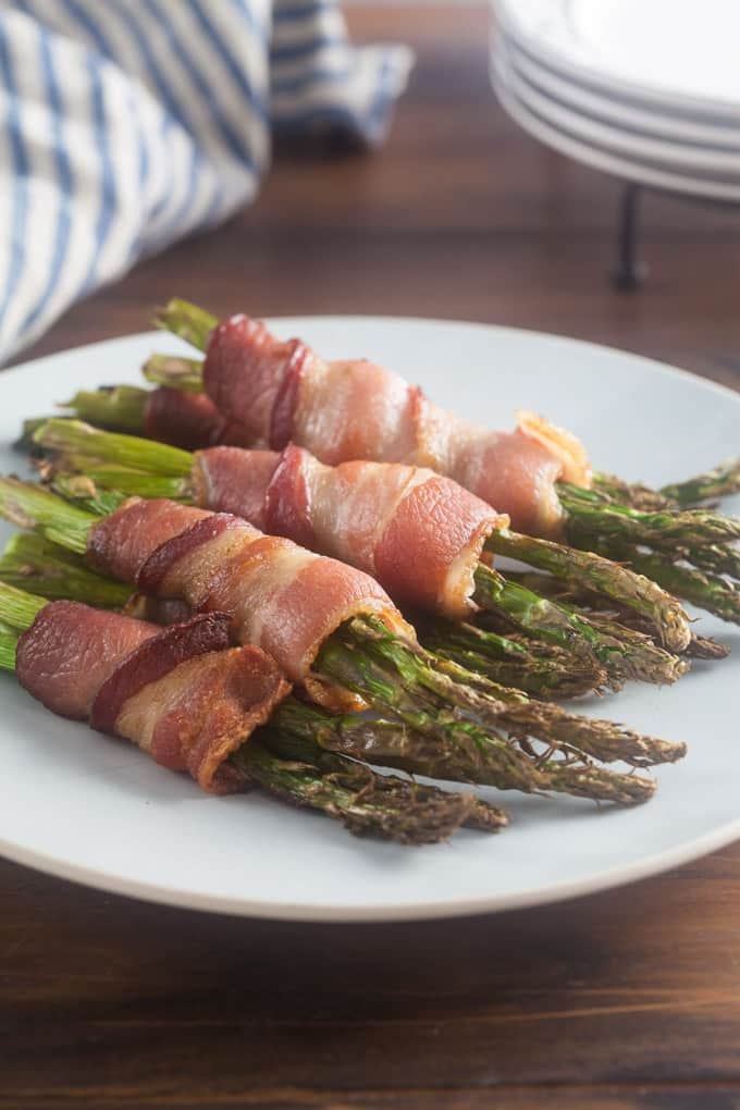 Asparagus is good on its own but the saying really is true - bacon makes everything better. It's the perfect way to dress up air fryer asparagus for a weeknight meal or party appetizer.