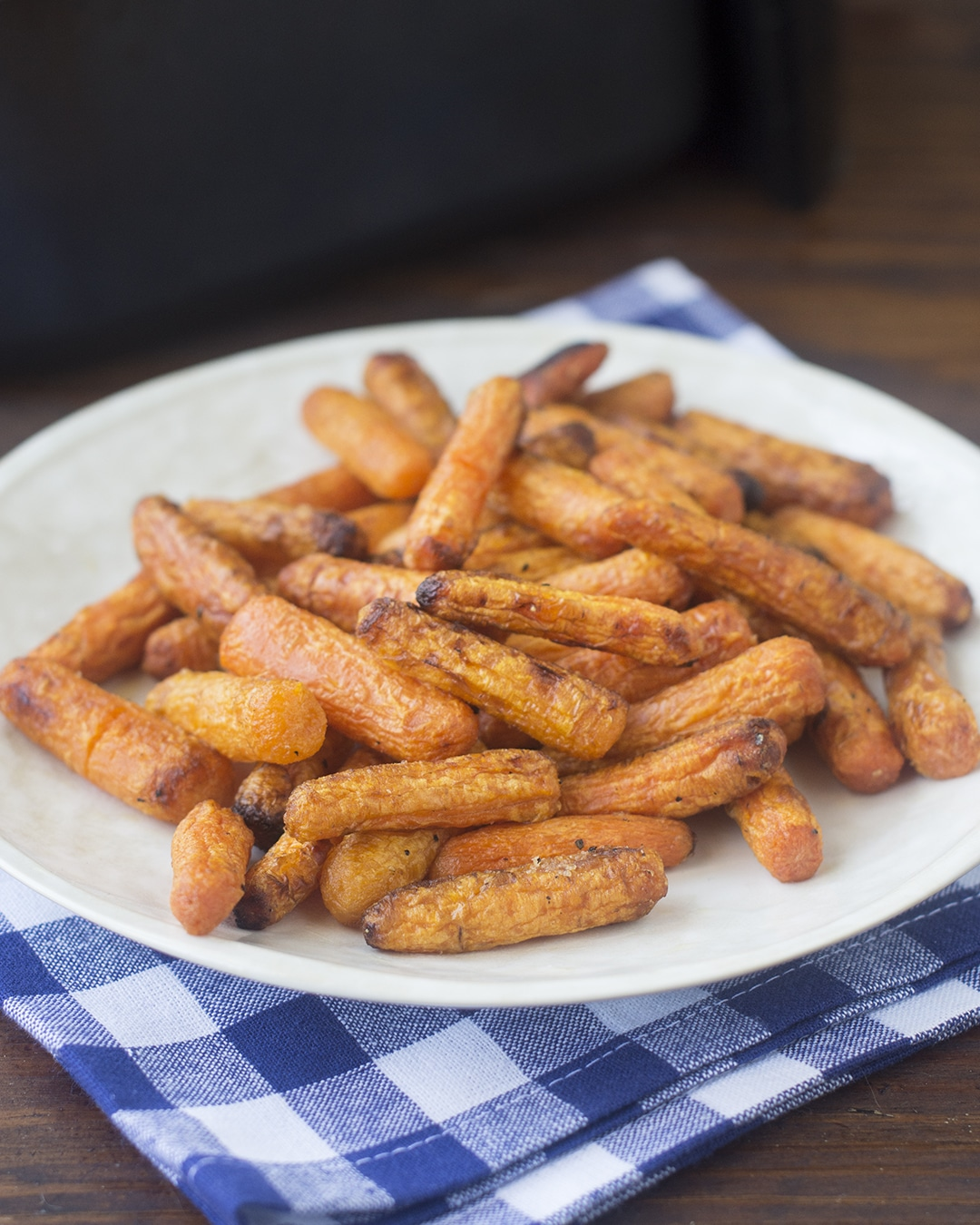 The air fryer is a wonderful tool for roasting vegetables quickly. One of my favorites to cook in there is carrots. They come out soft right through, and lightly caramelized on the outside, in just 10 minutes. Isn't that crazy? #airfryerrecipes #vegetablerecipes #carrotrecipes