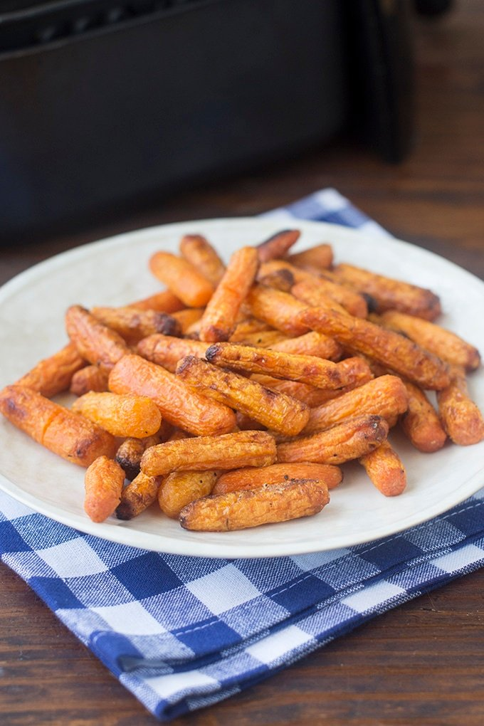 The air fryer is a wonderful tool for roasting vegetables quickly. One of my favorites to cook in there is carrots. They come out soft right through, and lightly caramelized on the outside, in just 10 minutes. Isn't that crazy?