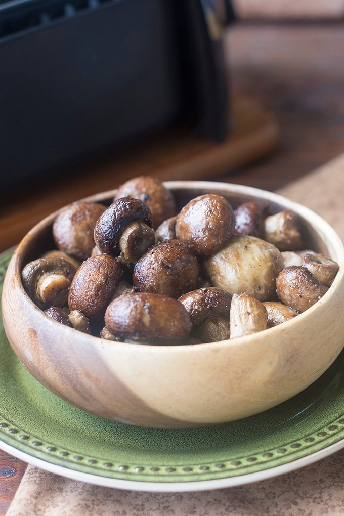 The air fryer is perfect for cooking whole mushrooms to use as a side dish for steak or to toss with pasta. They come out golden brown, softened, and full of juicy flavor.