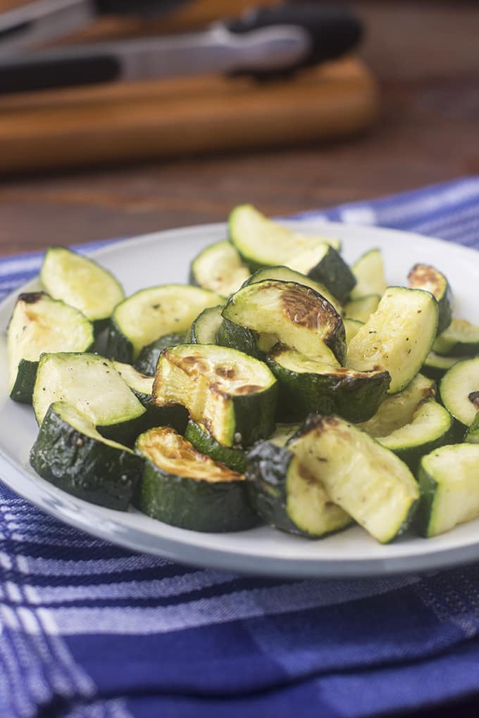 Zucchini is so delicious when cooked in the air fryer. It comes out nice and browned in places without being too mushy in the middle, and it only takes 8 minutes.