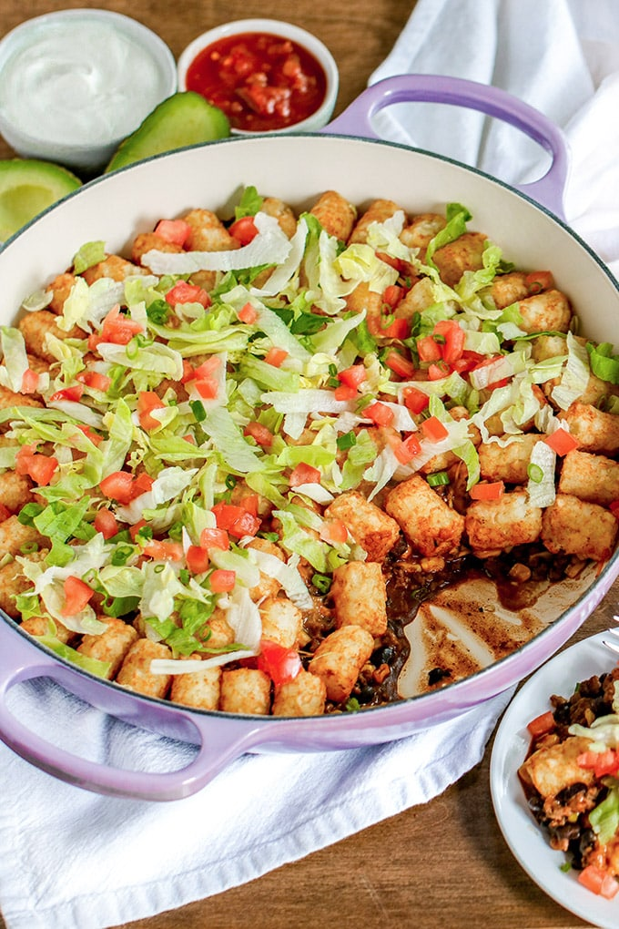 Tater Tot Taco Casserole takes two favorite meals and combines them - taco filling, toppings, and tater tots. What's not to love?!