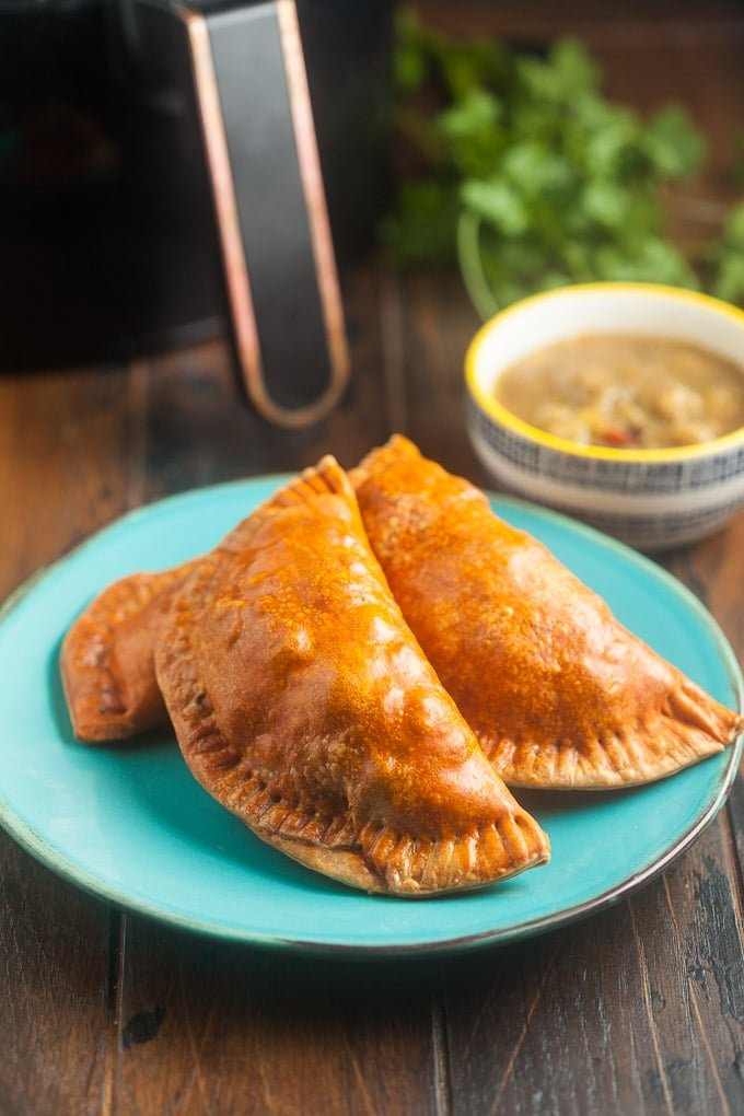 Air Fryer Empanadas are the perfect handheld appetizer or snack. They're just as tasty as the deep-fried version with much less grease.