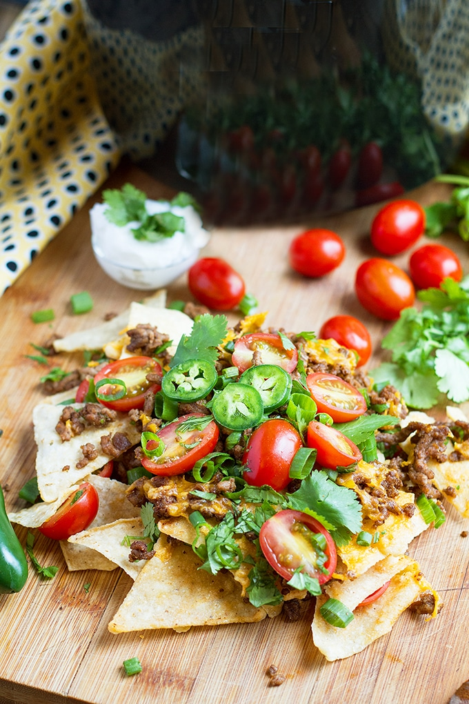 Air Fryer Nachos are a crowd favorite appetizer. Prep your ingredients ahead of time then serve them fresh out of the air fryer.