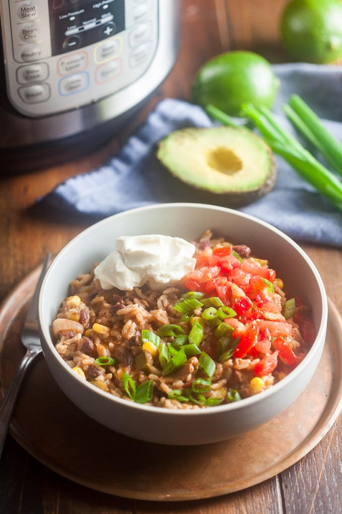 Instant Pot Burrito Bowls make dinner a breeze! The base cooks all together in about 30 minutes while you prep the toppings. #burritobowl #instantpotrecipes