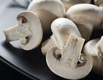 white mushrooms cut and whole