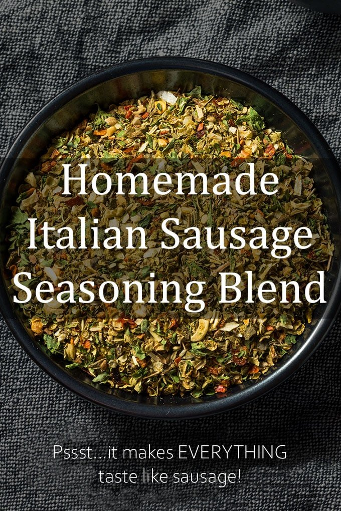 """Green seasoning in a bowl with the words """"Homemade Italian Sausage Seasoning Blend. Pssst...it makes EVERYTHING taste like sausage!"""""""