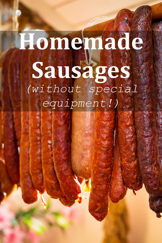 """A variety of types of sausages strung over a wooden stick. The words """"Homemade Sausages (without special equipment!)"""" appear on the image."""